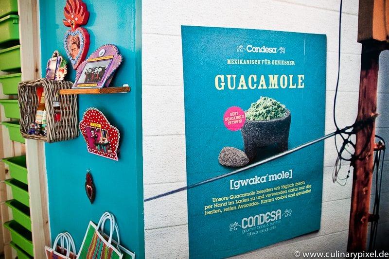 Guacamole Plakat an der Wand: Condesa Gourmet Tacos